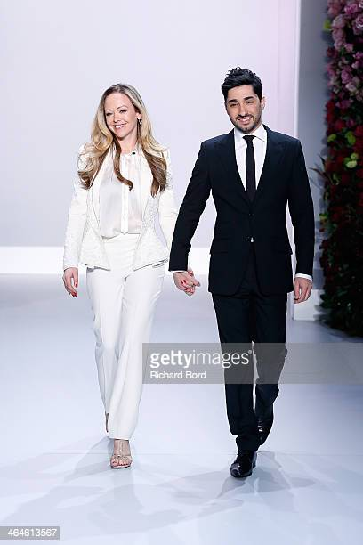 Tamara Ralph and Michael Russo walk the runway at the end of the Ralph Russo show as part of Paris Fashion Week Haute Couture Spring/Summer 2014 on...