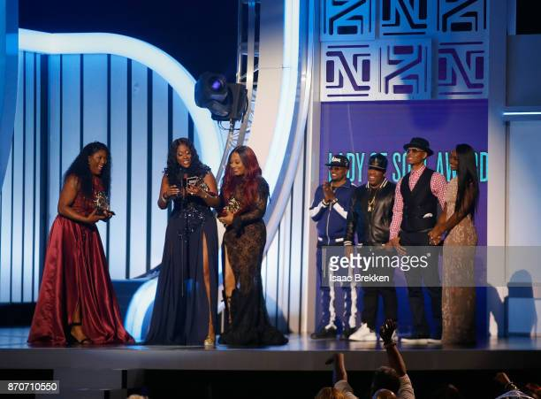 Tamara 'Taj' JohnsonGeorge Cheryl 'Coko' Clemons and Leanne 'Lelee' Lyons of SWV accept the Lady of Soul Award from Ronnie DeVoe Ricky Bell and...