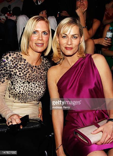 Tamara von Nayhauss and Gesine Cukrowski sit in front row during the Designer For Tomorrow show at the MercedesBenz Fashion Week Spring/Summer 2013...