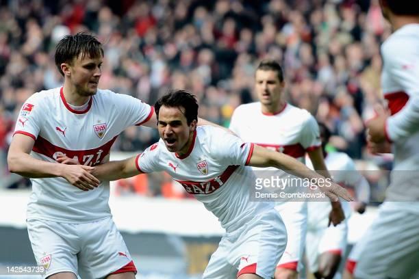 Tamas Hajnal of Stuttgart celebrates with teammate William Kvist after scoring his team's first goal during the Bundesliga match between VfB...