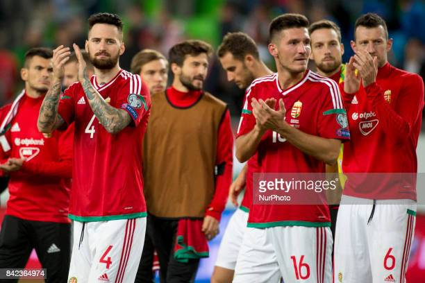 Tamas Kadar and Adam Pinter of Hungary thanks their fans during the FIFA World Cup 2018 Qualifying Round match between Hungary and Portugal at...