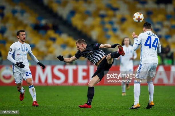 Tamas Kadar of FC Dynamo Kyiv tackles Ognjen Ozegovic of FK Partizan Belgrade during the UEFA Europa League group B match between FC Dynamo Kyiv and...