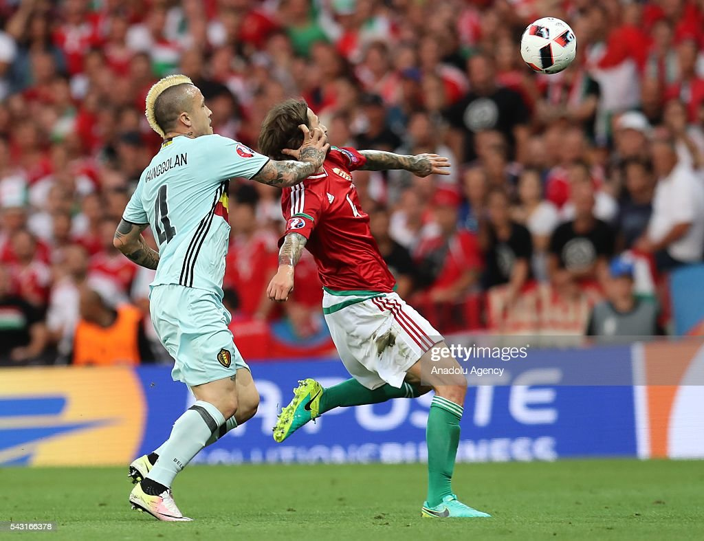 Tamas Kadar (R) of Hungary in action against Radja Nainggolan (L) of Belgium during the UEFA Euro 2016 round of 16 football match between Hungary and Belgium at Stadium Municipal in Toulouse, France on June 26, 2016.