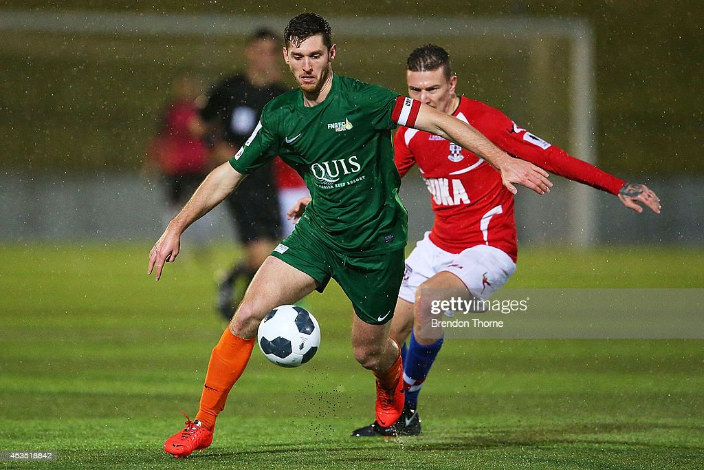 Tamas Maffey-Stumpe of the Heat competes with Mirjian Pavlovic of United during the FFA Cup match between Sydney United 58 FC and the FNQ Heat at Sydney United Sports Centre on August 12, 2014 in Sydney, Australia.