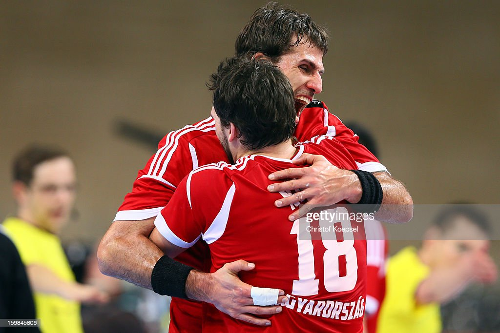 <a gi-track='captionPersonalityLinkClicked' href=/galleries/search?phrase=Tamas+Mocsai&family=editorial&specificpeople=843024 ng-click='$event.stopPropagation()'>Tamas Mocsai</a> and Kornel Nagy of Hungary celebrate after the round of sixteen match between Hungary and Poland at Palau Sant Jordi on January 21, 2013 in Barcelona, Spain. The match between Hungary and Poland ended 27-19.