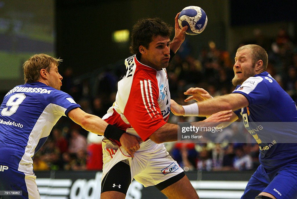 Tamas Mocsai of Hungary (C) in action with Gudjon Valur Sigurdsson (L) and Sigfus Sigurdsson (R) of Iceland during the Men's Handball European Championship main round Group II match between Hungary and Iceland at Trondheim Spektrum on January 23, 2008 in Trondheim, Norway.