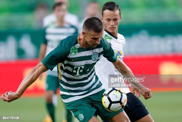 Tamas Priskin of Ferencvarosi TC wins the ball from Zoltan Medgyes of Swietelsky Haladas during the Hungarian OTP Bank Liga match between...