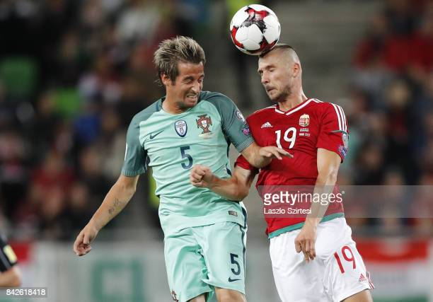 Tamas Priskin of Hungary and Fabio Coentrao of Portugal in action during the FIFA 2018 World Cup Qualifier match between Hungary and Portugal at...