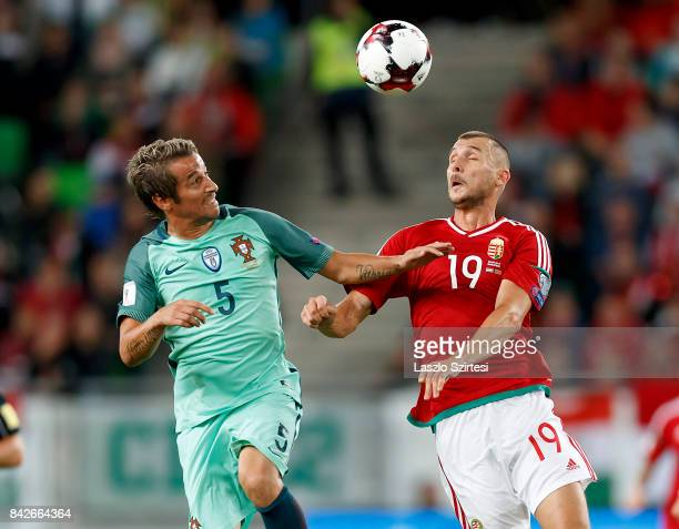 Tamas Priskin of Hungary competes for the ball in the air with Fabio Coentrao of Portugal during the FIFA 2018 World Cup Qualifier match between...
