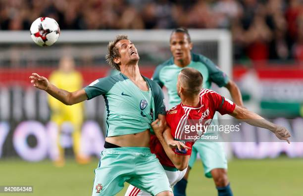 Tamas Priskin of Hungary tangles with Fabio Coentrao of Portugal during the FIFA 2018 World Cup Qualifier match between Hungary and Portugal at...