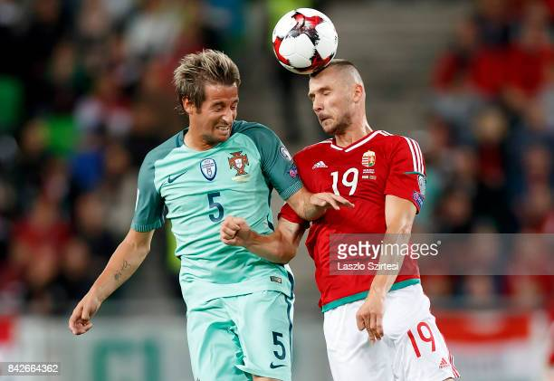 Tamas Priskin of Hungary wins the ball in the air from Fabio Coentrao of Portugal during the FIFA 2018 World Cup Qualifier match between Hungary and...