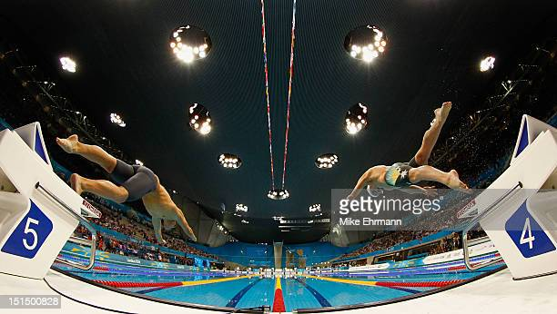 Tamas Toth of Hungary and Matthew Cowdrey of Australia swim in the Men's 50m Freestyle S9 on day 7 of the London 2012 Paralympic Games at Aquatics...