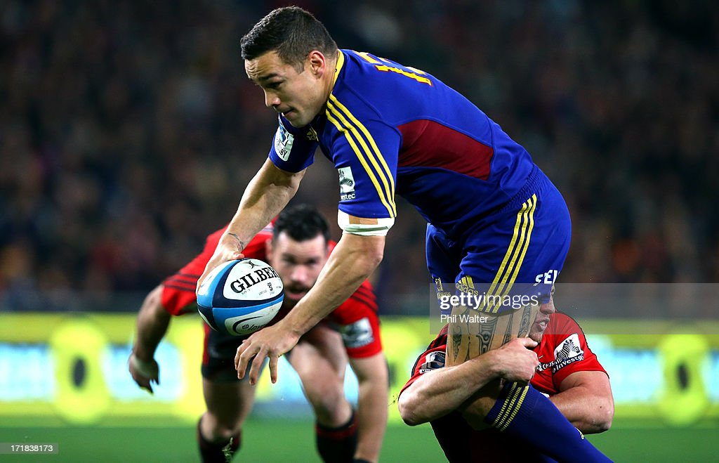 Tamati Ellison of the Highlanders ia tackled during the round 18 Super Rugby match between the Highlanders and the Crusaders at Forsyth Barr Stadium on June 29, 2013 in Dunedin, New Zealand.