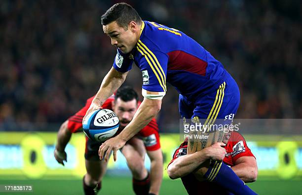 Tamati Ellison of the Highlanders ia tackled during the round 18 Super Rugby match between the Highlanders and the Crusaders at Forsyth Barr Stadium...