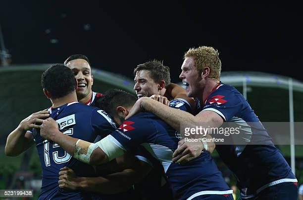 Tamati Ellison of the Rebels celebrates with team mates after scoring during the round nine Super Rugby match between the Melbourne Rebels and the...