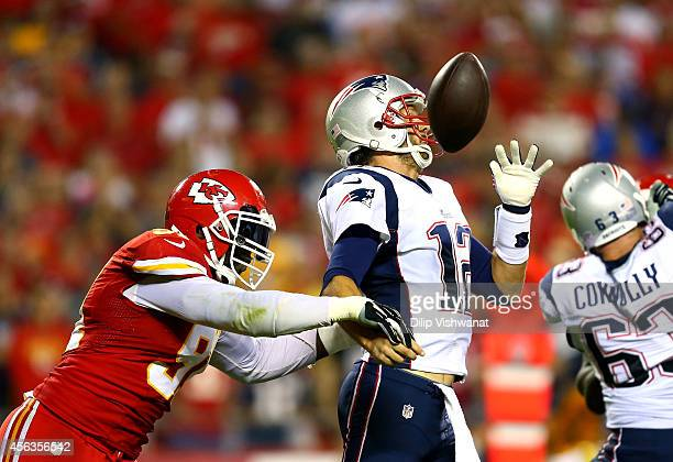 Tamba Hali of the Kansas City Chiefs knocks the ball loose from Tom Brady of the New England Patriots for a fumble during the third quarter at...