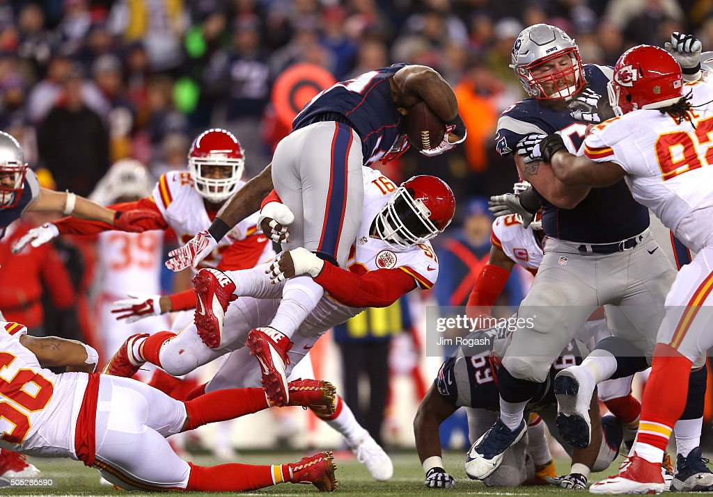 Tamba Hali of the Kansas City Chiefs tackles Steven Jackson in the first half during the AFC Divisional Playoff Game at Gillette Stadium on January...