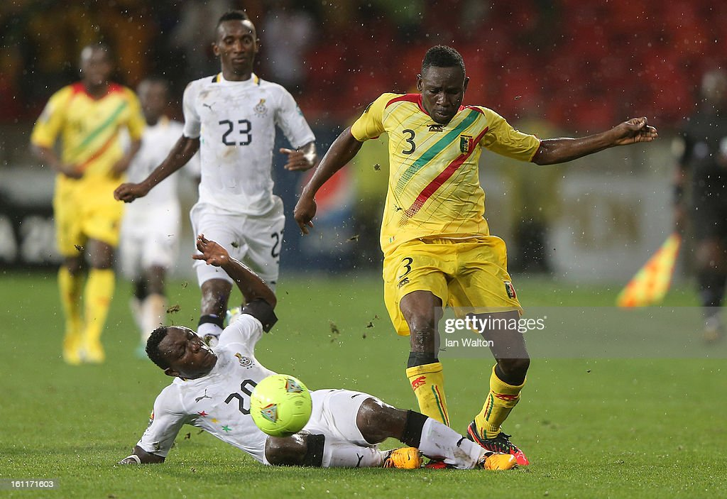 Tamboura Adama of Mali is tackled by Asamoah Kwadwo of Ghana during the 2013 Africa Cup of Nations Third Place Play-Off match between Mali and Ghana on February 9, 2013 in Port Elizabeth, South Africa.