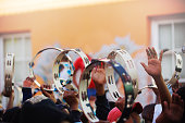 Tambourines held high during a street Carnival parade Kaapse Klopse Cape Malay Quarters Cape Town