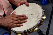 Tambourine being played by a ritimist during a samba performance in Rio de Janeiro