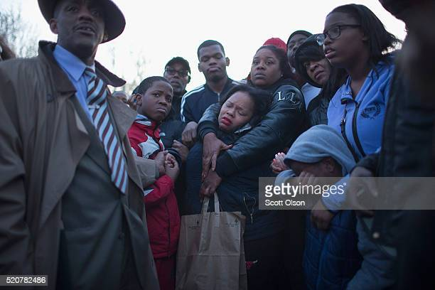Tambrasha Hudson is comforted as she joins demonstrators protesting the shooting death of her son 16yearold Pierre Loury near the location where he...