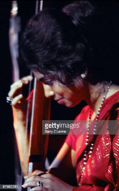 Tambura player Maya Kulkarni accompanying the sitarist Ravi Shankar at the Woodstock Music and Arts Fair in Bethel New York August 15 17 1969