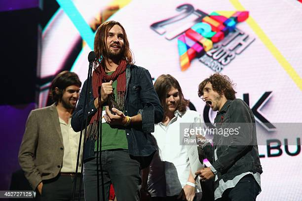 Tame Impala accept the award for 'Best Rock Album' during the 27th Annual ARIA Awards 2013 at the Star on December 1 2013 in Sydney Australia