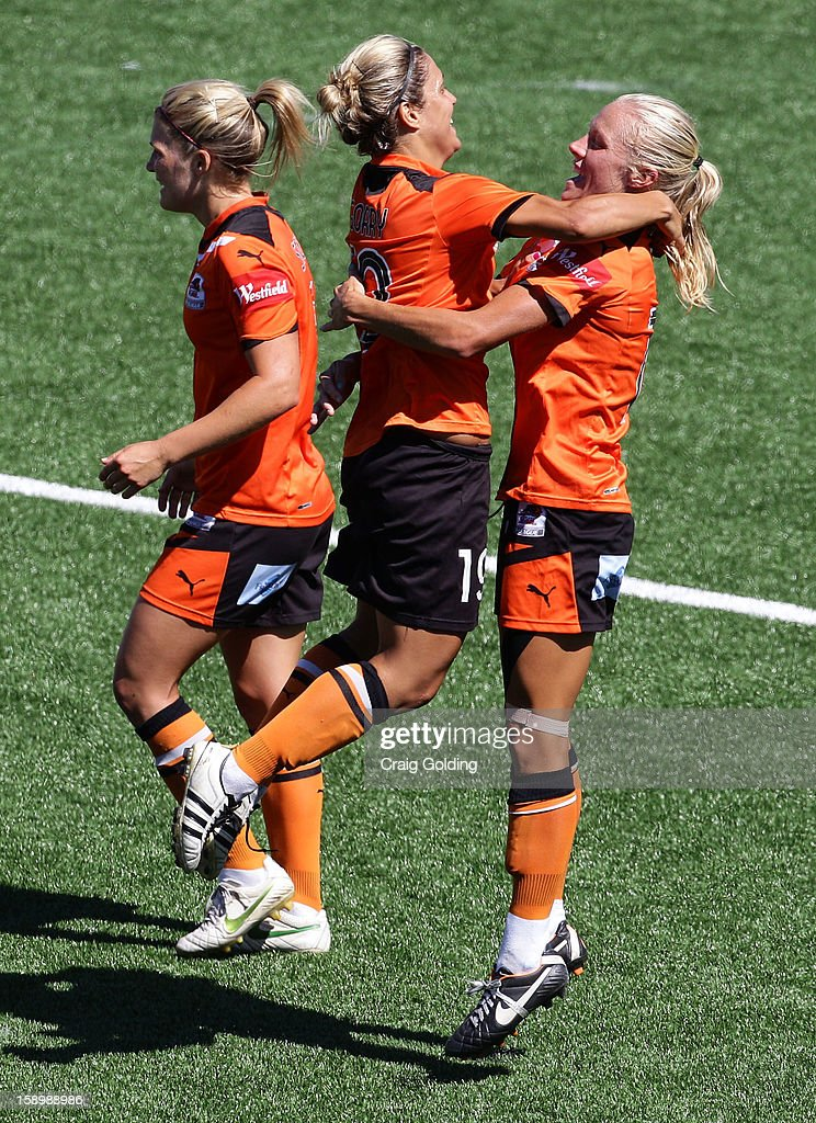 Tameka Butt and Katrina Gorry of the Roar celebrate after Butt's goal during the round 11 W-League match between Sydney FC and the Brisbane Roar on January 5, 2013 in Sydney, Australia.