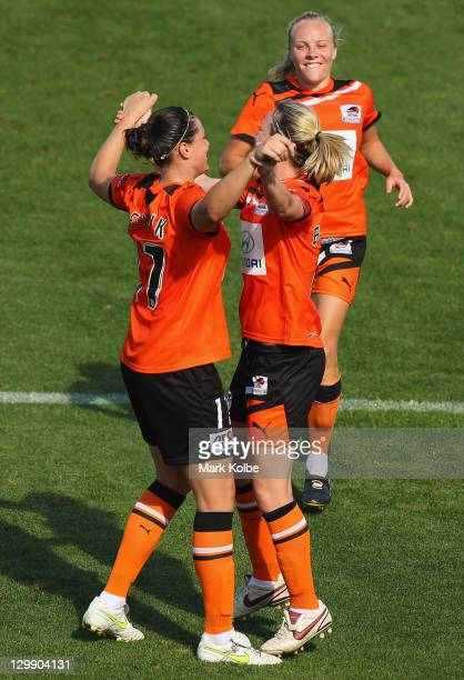 Tameka Butt of the Roar runs to join Emily Gielnik and Joanne Burgess of the Roar as they celebrate after Burgess scored a goal during the round one...