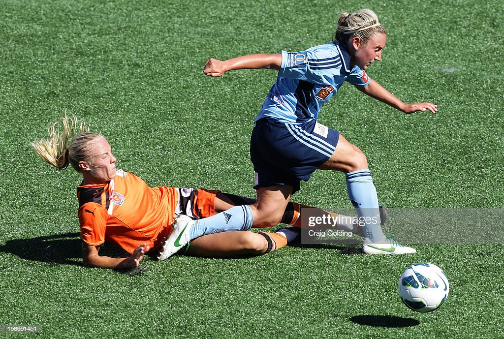 Tameka Butt slides in to tackle Annalie Longo of Sydney during the round 11 W-League match between Sydney FC and the Brisbane Roar on January 5, 2013 in Sydney, Australia.