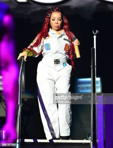 Tameka Cottle of Xscape performs during The Great Xscape tour at American Airlines Arena on December 5 2017 in Miami Florida
