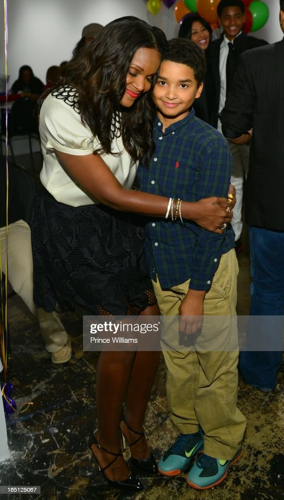 <a gi-track='captionPersonalityLinkClicked' href=/galleries/search?phrase=Tameka+Foster&family=editorial&specificpeople=4117530 ng-click='$event.stopPropagation()'>Tameka Foster</a> and and her son Kile's friend attend the birthday and foundation lanuch Kile's World to honor Kile Glover at the Woodruff Arts Center on March 29, 2013 in Atlanta, Georgia.