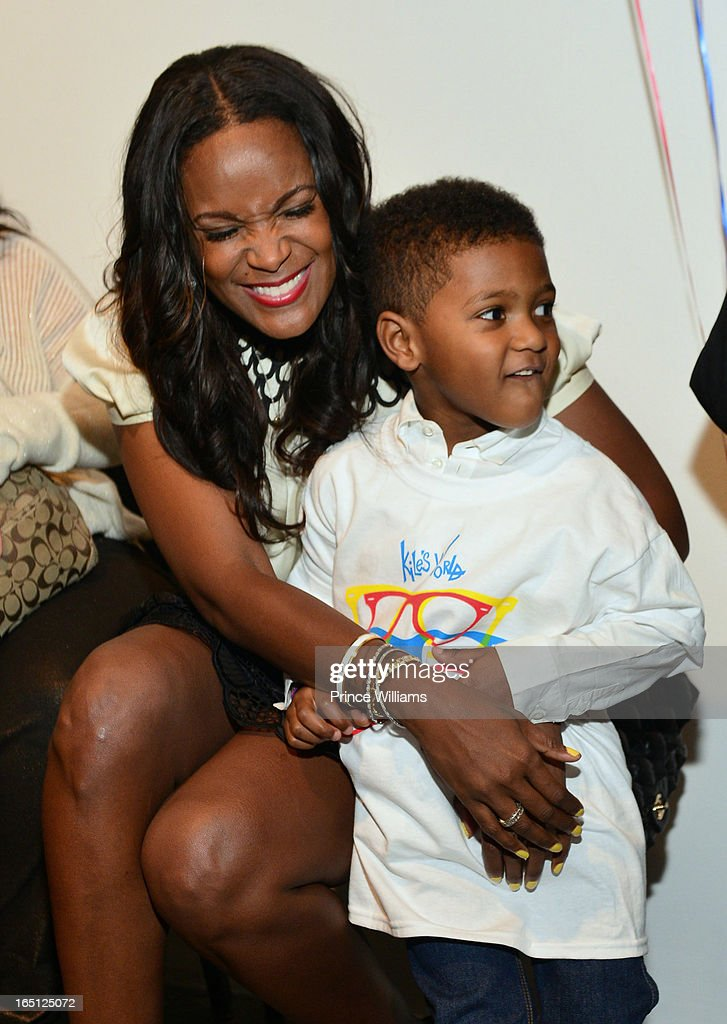 <a gi-track='captionPersonalityLinkClicked' href=/galleries/search?phrase=Tameka+Foster&family=editorial&specificpeople=4117530 ng-click='$event.stopPropagation()'>Tameka Foster</a> and Naviyd Raymond attend the birthday and foundation lanuch Kile's World to honor Kile Glover at the Woodruff Arts Center on March 29, 2013 in Atlanta, Georgia.