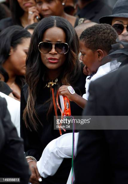 Tameka Foster and Naviyd Raymond walk out behind the casket after the funeral of Kile Glover at the Wieuca Road Baptist Church on July 27 2012 in...