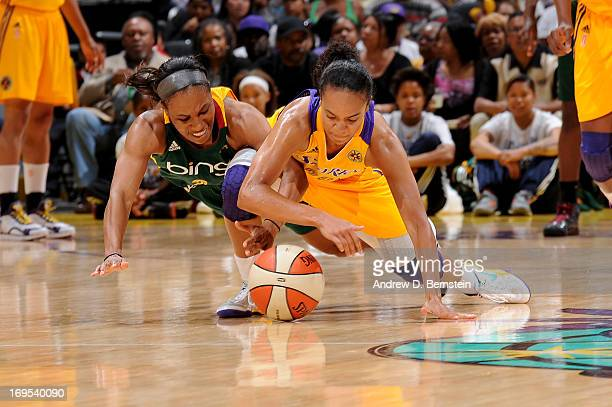 Tameka Johnson of the Seattle Storm and Kristi Toliver of the Los Angeles Sparks dive for the basketball during a game at Staples Center on May 26...