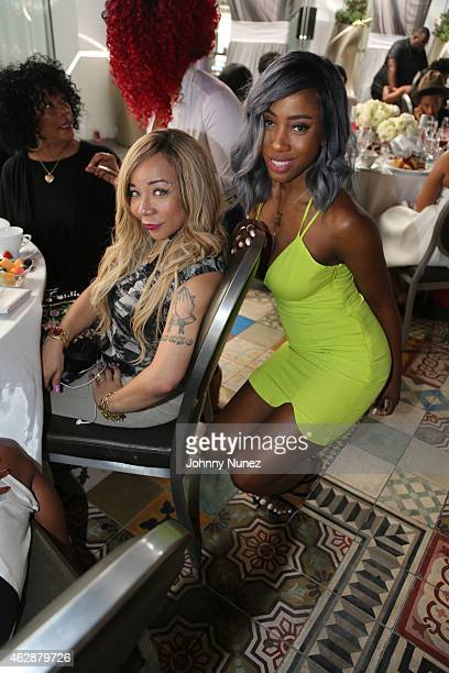 Tameka 'Tiny' CottleHarris and Sevyn Streeter attend MILF Celebration Of Entertainment Mothers on February 6 2015 in Beverly Hills California