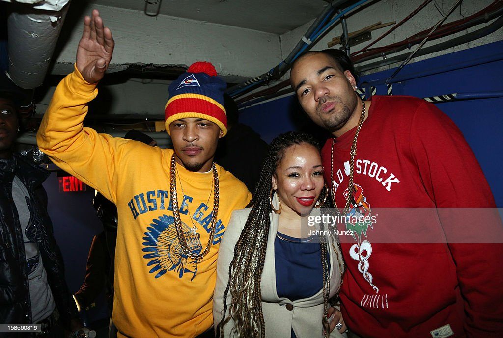 T.I., Tameka 'Tiny' Harris, and DJ Envy attend 'T.I. In Concert' at Best Buy Theater on December 18, 2012 in New York, United States.