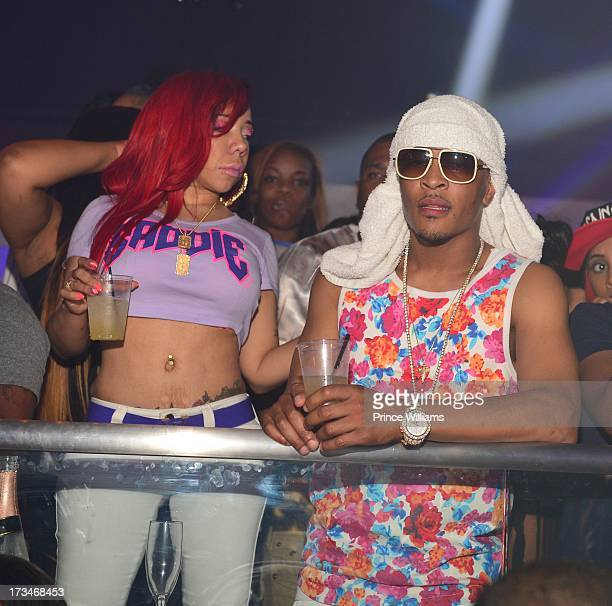 Tameka 'Tiny' Harris and TI attend a party hosted by TI and Lil Wayne at Prive on July 12 2013 in Atlanta Georgia