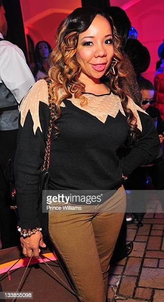 Tameka 'Tiny' Harris attend Reginae Carter's 13th Birthday party at The Callanwolde Mansion on November 19 2011 in Atlanta Georgia