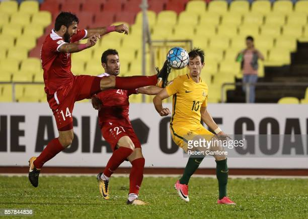 Tamer Hag Mohamad of Syria challenges Robbie Kruse of Australia during the 2018 FIFA World Cup Asian Playoff match between Syria and the Australia...