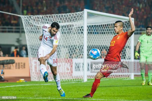 Tamer Mohamd of Syria battles for the ball with Zhang Yuning of China PR during their 2018 FIFA World Cup Russia Final Qualification Round Group A...