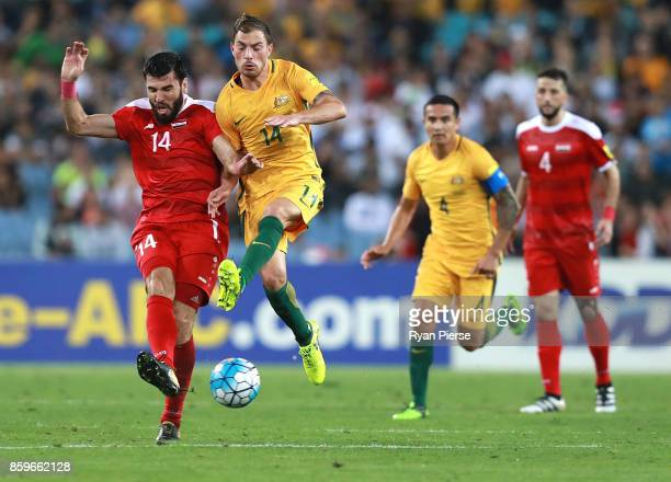 Tamer Mohamd of Syria competes for the ball against James Troisi of Australia during the 2018 FIFA World Cup Asian Playoff match between the...