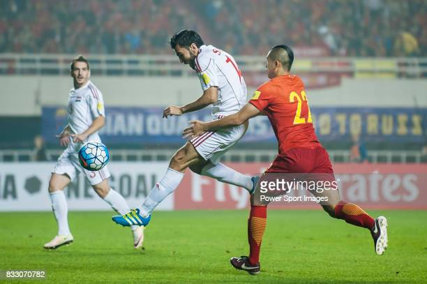 Tamer Mohamd of Syria fights for the ball with Zhang Yuning of China PR during their 2018 FIFA World Cup Russia Final Qualification Round Group A...