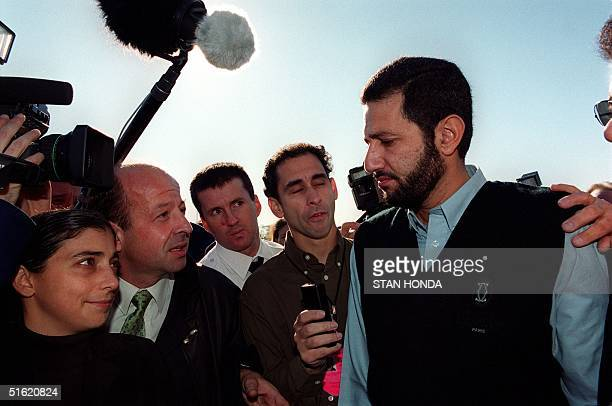 Tamer Omer of Cairo Egypt talks to members of the media outside a Ramada Inn 01 November at Kennedy Airport in New York Omer's brother Heshem was a...