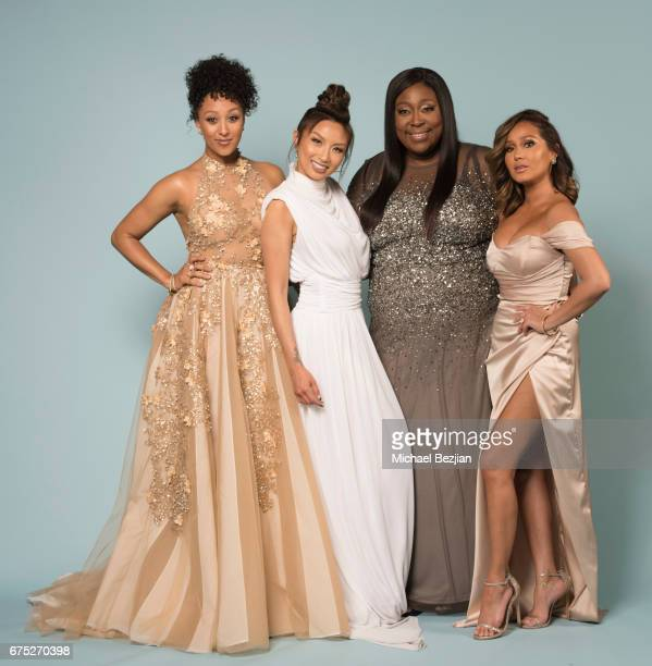 Tamera Mowry Jeannie Mai Loni Love and Adrienne Bailon pose for a portrait at 'Portraits by The Artists Project Sponsored by Foster Grant on' during...