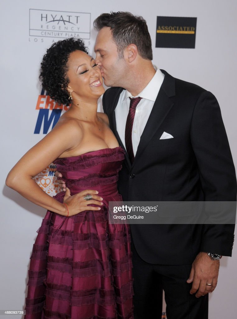 Tamera Mowry-Housley and Adam Housley arrive at the 21st Annual Race To Erase MS Gala at the Hyatt Regency Century Plaza on May 2, 2014 in Century City, California.