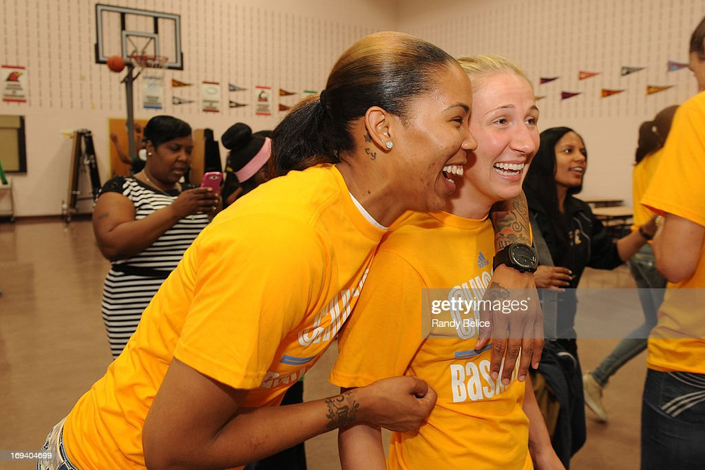 Tamera Young #1 and Courtney Vandersloot #22 of the Chicago Sky share a laugh during a Chicago Sky Cares food distribution event in partnership with the Greater Chicago Food Depostitory on May 22, 2013 at the Jacob Beidler Elementary School in Chicago, Illinois. The event is part of the WNBA Cares week of service activities.