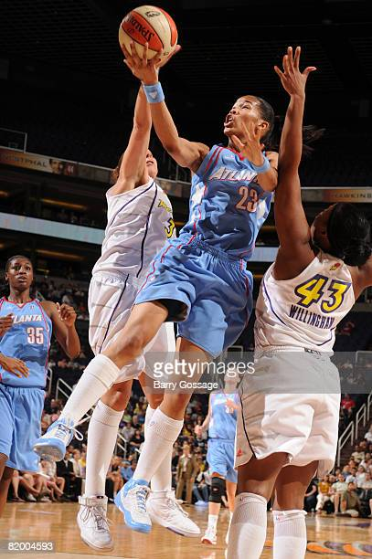 Tamera Young of the Atlanta Dream shoots against Le'coe Willingham of the Phoenix Mercury on July 19 at US Airways Center in Phoenix Arizona NOTE TO...