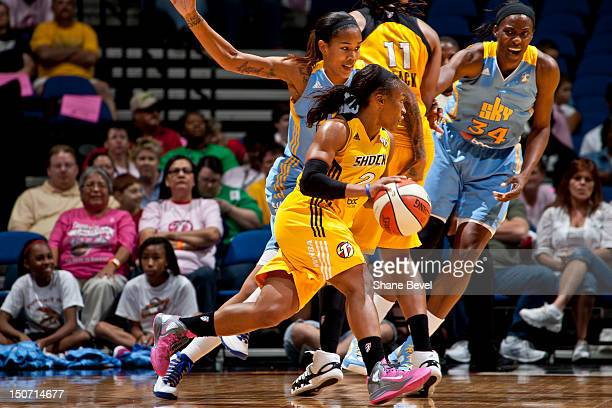 Tamera Young of the Chicago Sky gets block by Chante Black at Temeka Johnson of the Tulsa Shock drive around the outside during the WNBA game on...