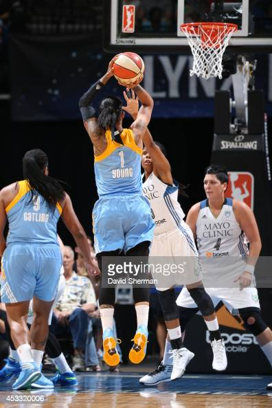 Tamera Young of the Chicago Sky goes for the shot against Tan White of the Minnesota Lynx during the WNBA game on August 7 2014 at Target Center in...